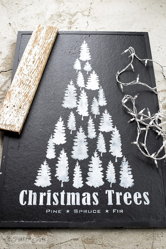 Illuminated Christmas Trees mantel sign on a bulletin board with Funky Junk's Old Sign Stencils and Fusion Mineral Paint