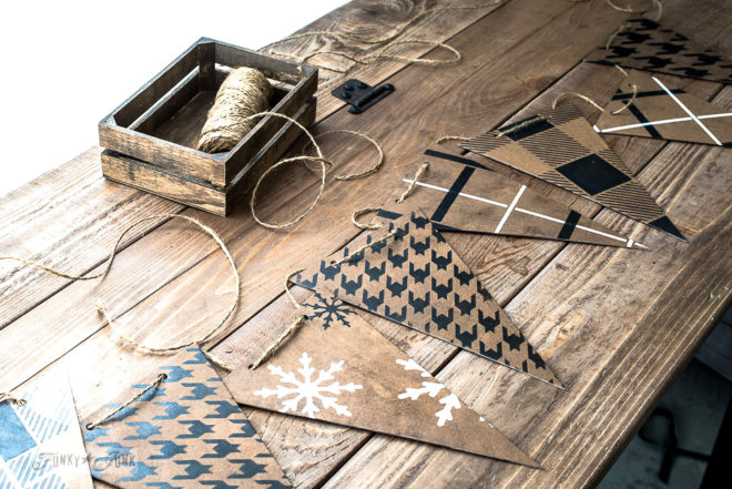 Create this cardboard stenciled banner that resembles leather, using Funky Junk's Old Sign Stencils Buffalo Check, Houndstooth, Plaid Shirt and snowflakes, with Fusion Mineral Paint