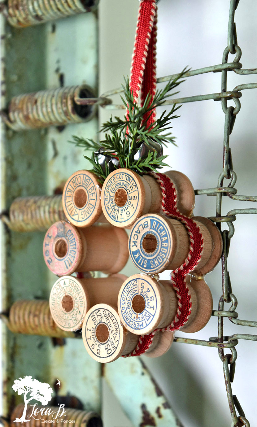 Vintage thread spool Christmas wreath ornaments by Lora B, featured on Funky Junk Interiors