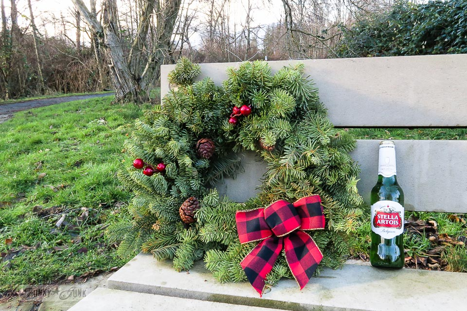 A Christmas wreath with a full bottle of beer - A Christmas bike ride along the Vedder River Rotary Trail in Chilliwack BC.