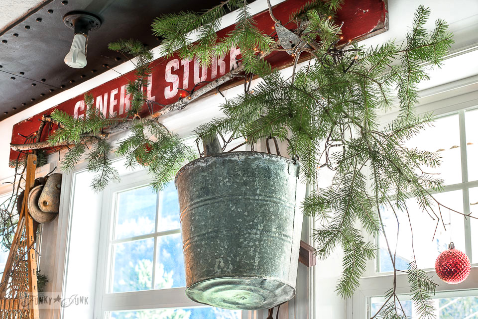 Red General Store sign and snowshoe in a Christmas kitchen home tour