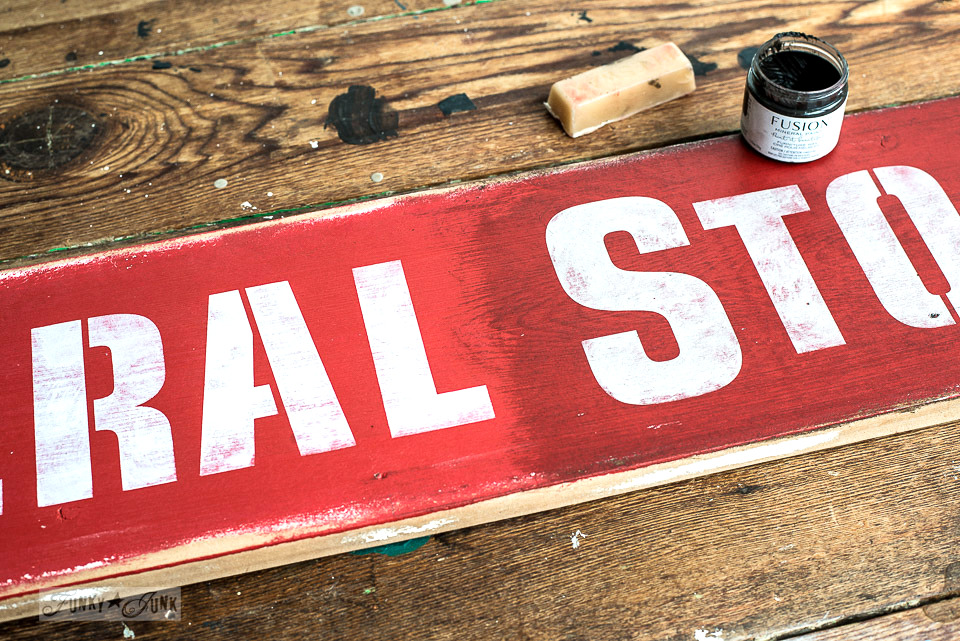 Learn how to make a red General Store sign aged with wax, giving it an authentically old finish! With Funky Junk's Old Sign Stencils and Fusion Mineral Paint.