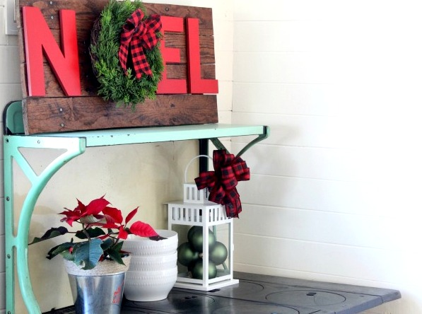 Rustic-Christmas-pallet-noel-wreath-sign-on-antique-stove-with-ornaments-in-lantern-Knick-of-Time