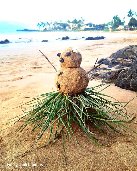 Sand snowman with a grass skirt in Maui, Hawaii.41 PM.png