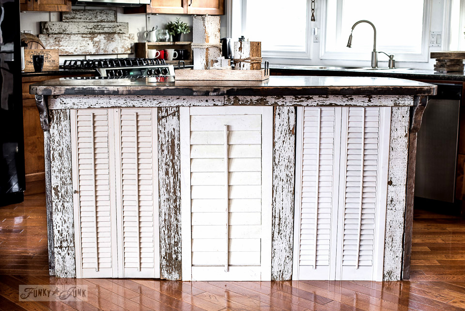 30 minute chippy wood kitchen island revamp with some shutters and old fence wood for a rustic kitchen.