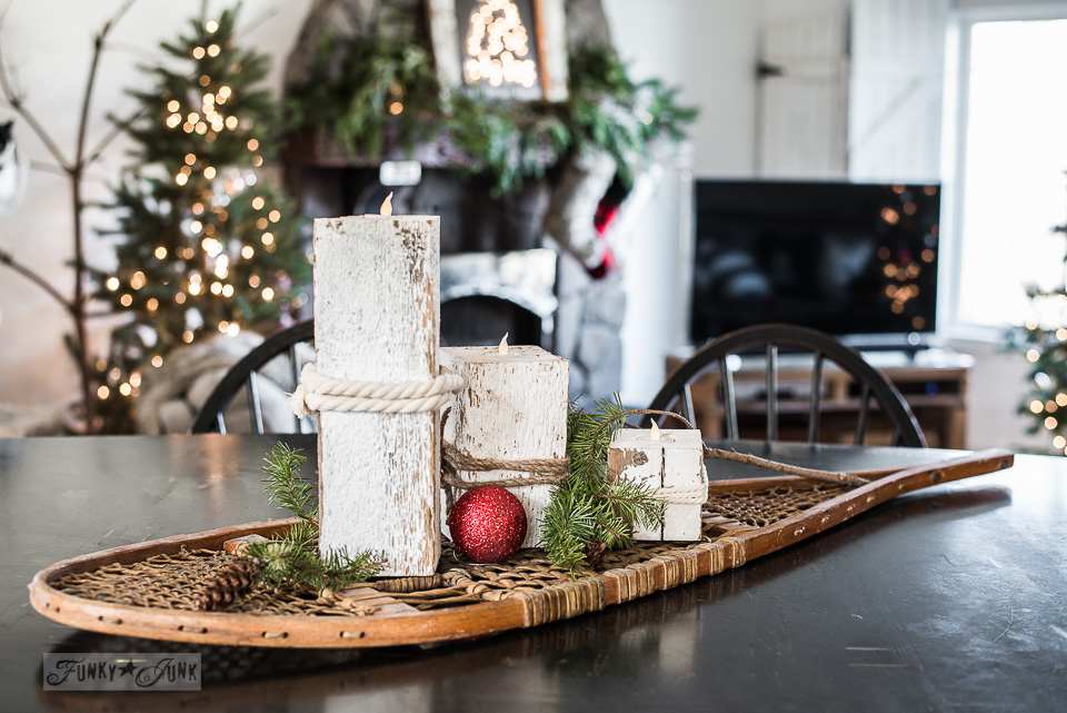 Snowshoe and reclaimed wood candle centrepiece in a Christmas kitchen tour