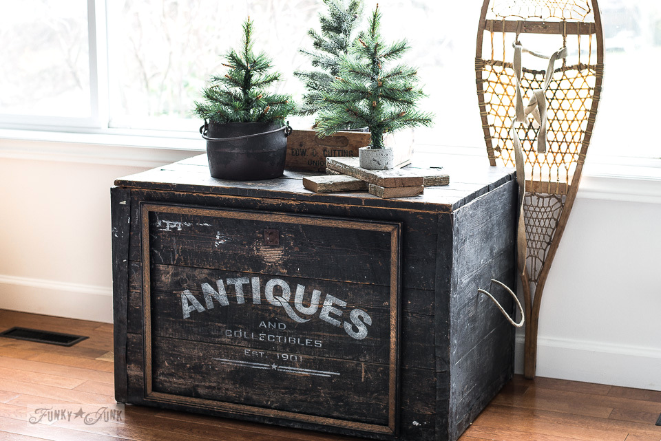 Antiques storage trunk with winter trees and snowshoe for winter decor