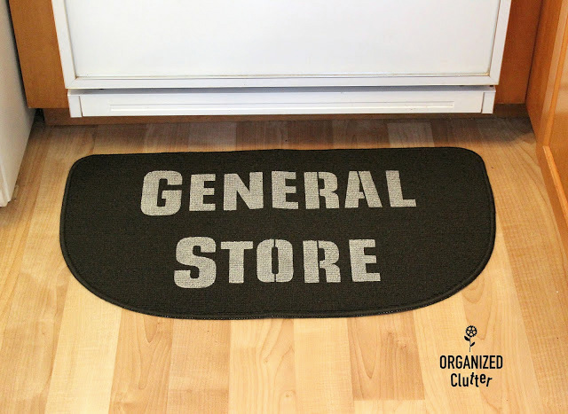 Stenciled General Store kitchen rug by Organized Clutter, featured on Funky Junk Interiors