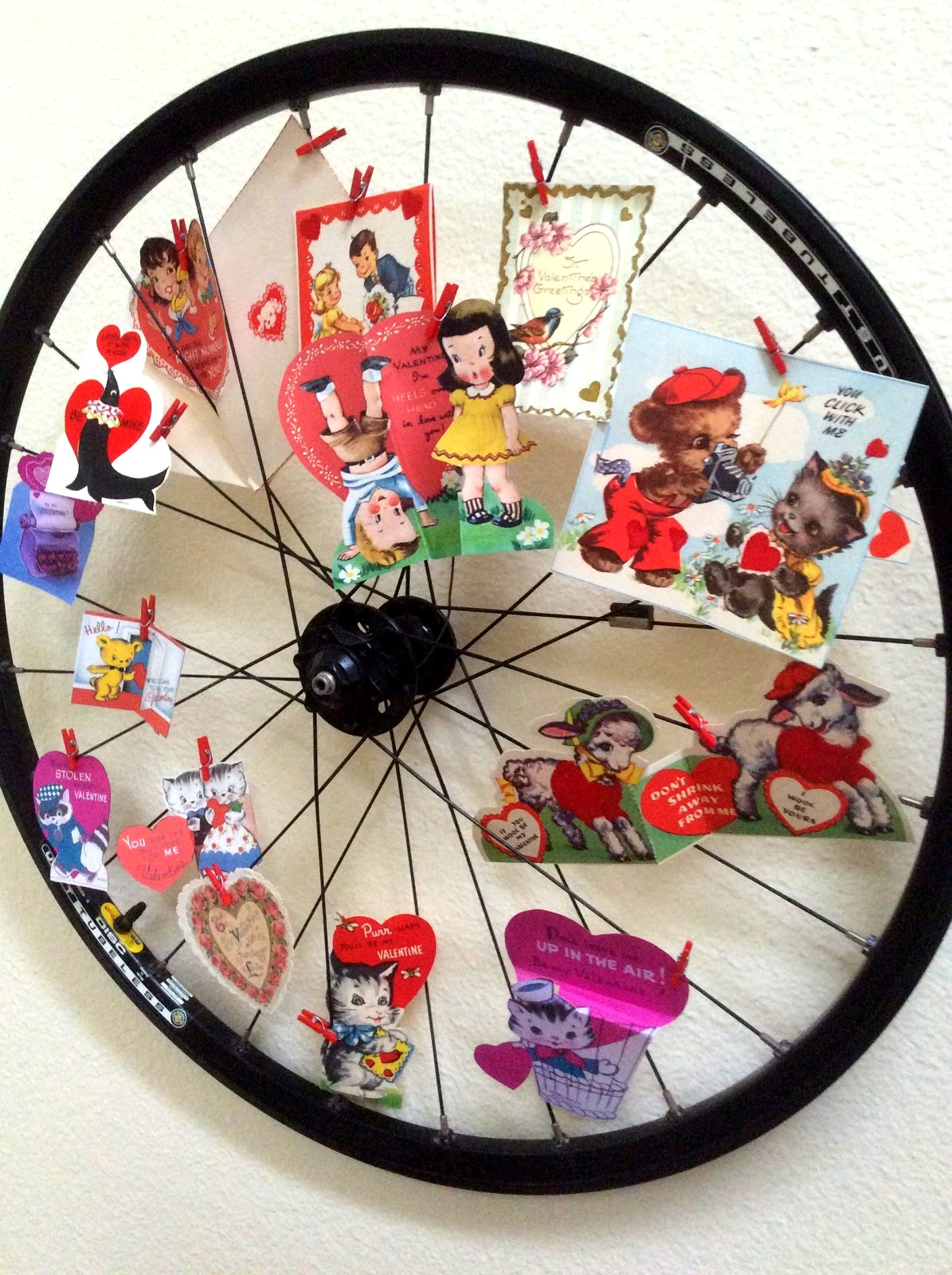 Valentine's Day card bike wheel display by Fresh Vintage by Lisa S, featured on Funky Junk Interiors