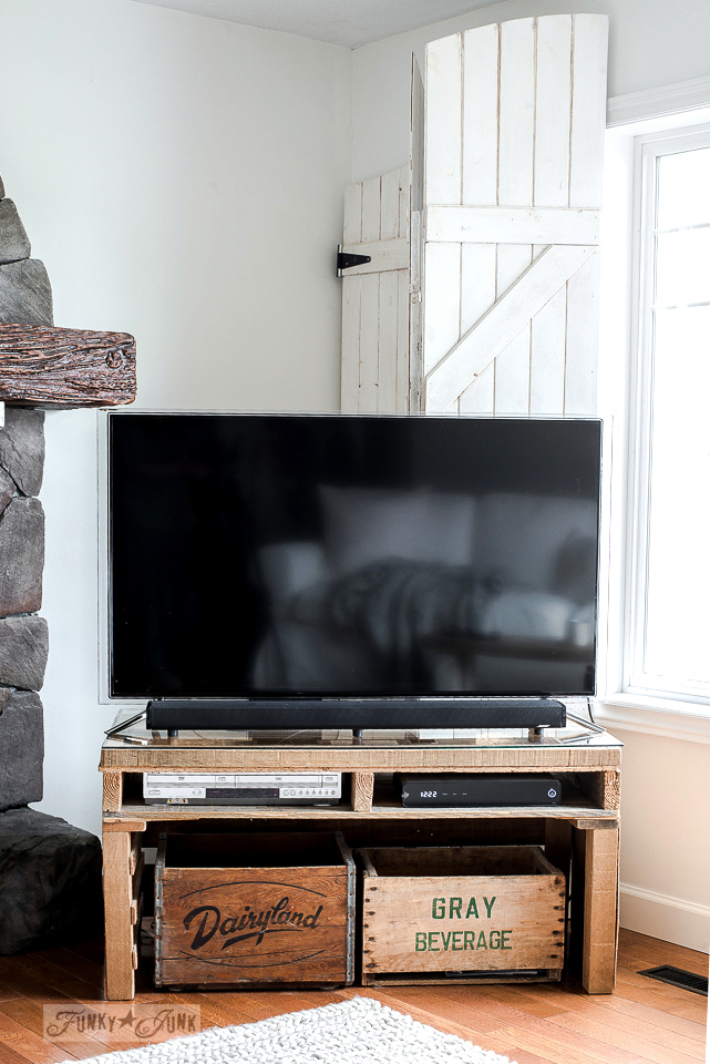 Pallet wood and vintage crate big screen TV media stand in a rustic living room