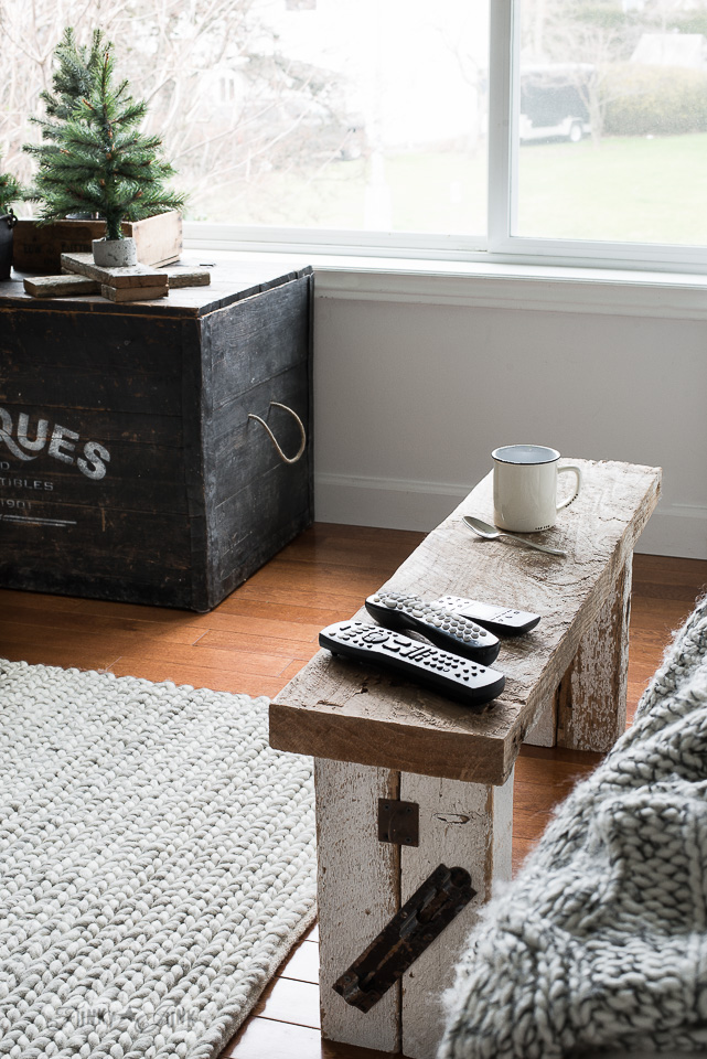 reclaimed wood bench coffee table in rustic winter living room