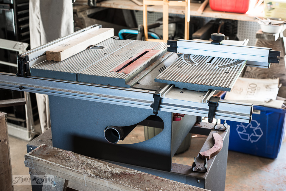"Ryobi 10"" table saw on bench in a workshop"