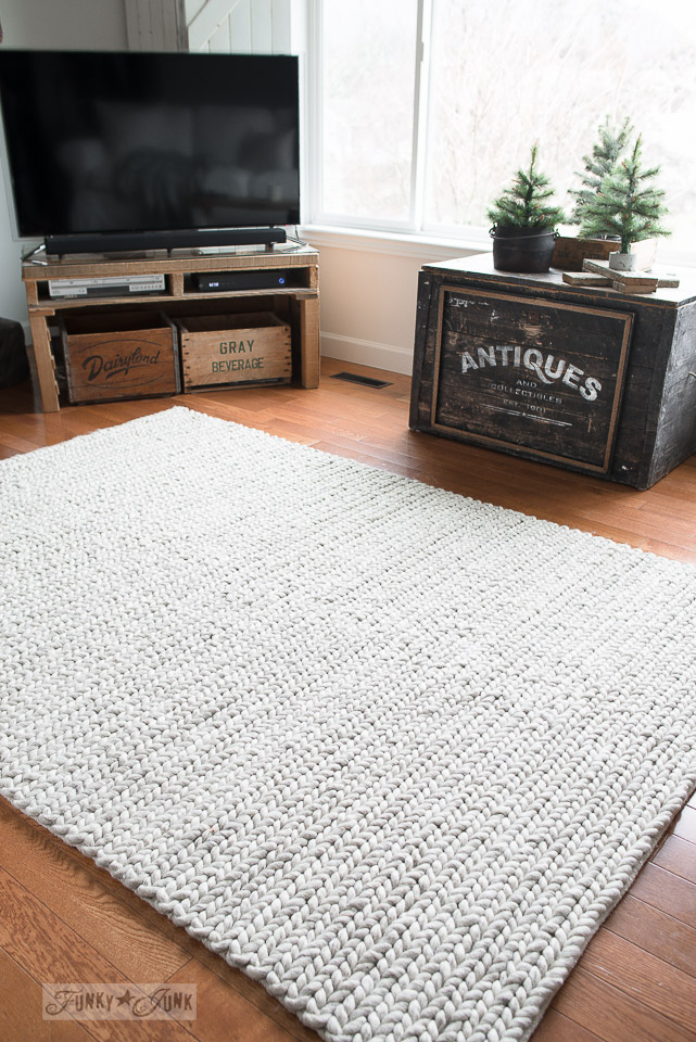 White Hjortsvang Ikea carpet that has a woven weave resembling a bulky sweater. 100% wool and gorgeous!
