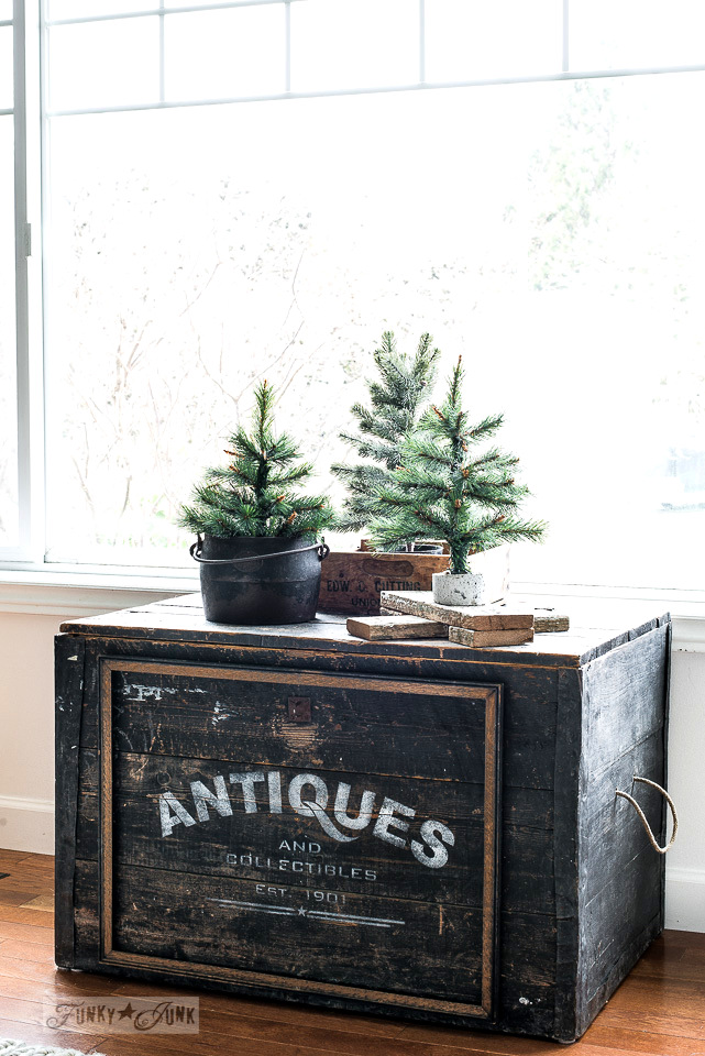 Winter faux trees on a black stenciled Antiques trunk made with Funky Junk's Old Sign Stencils