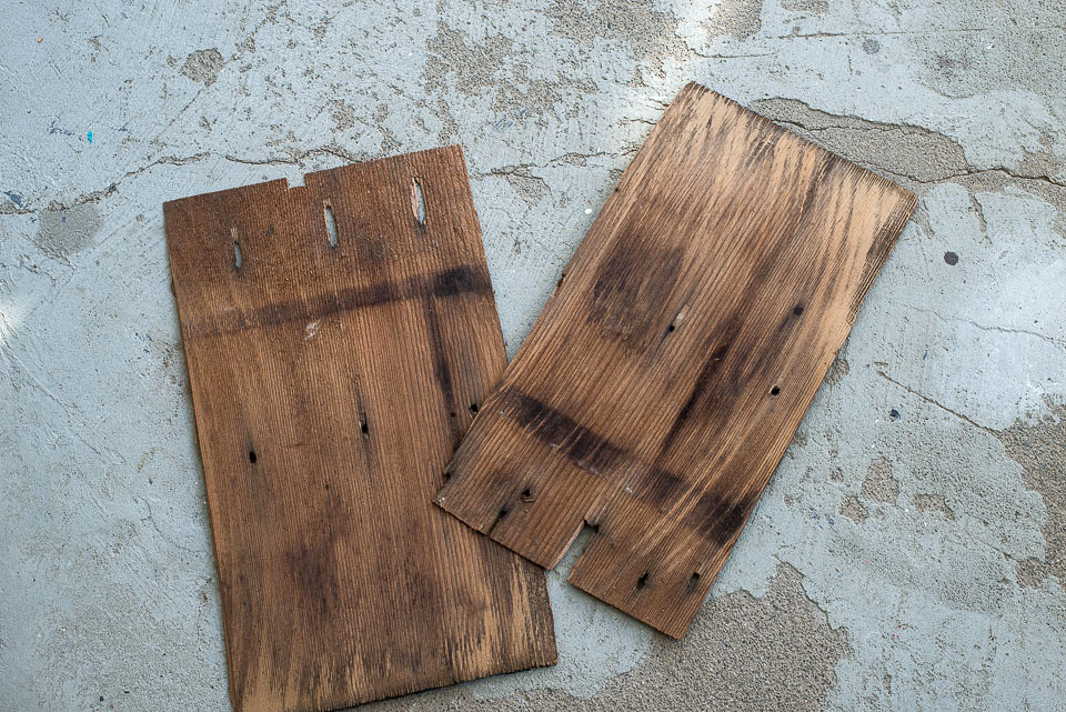 Wooden shingles used as rustic wood panel door insets about to get a houndstooth pattern for a vintage side table makeover.