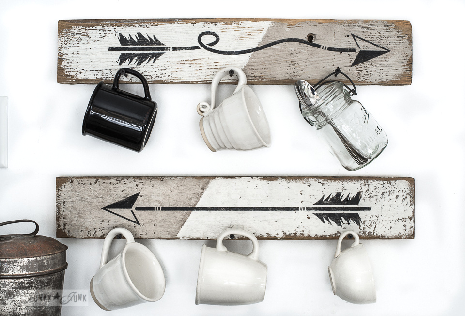Learn how to stencil arrow planks to become instant coffee mug hooks, perfect for a coffee station! Click to read full tutorial.