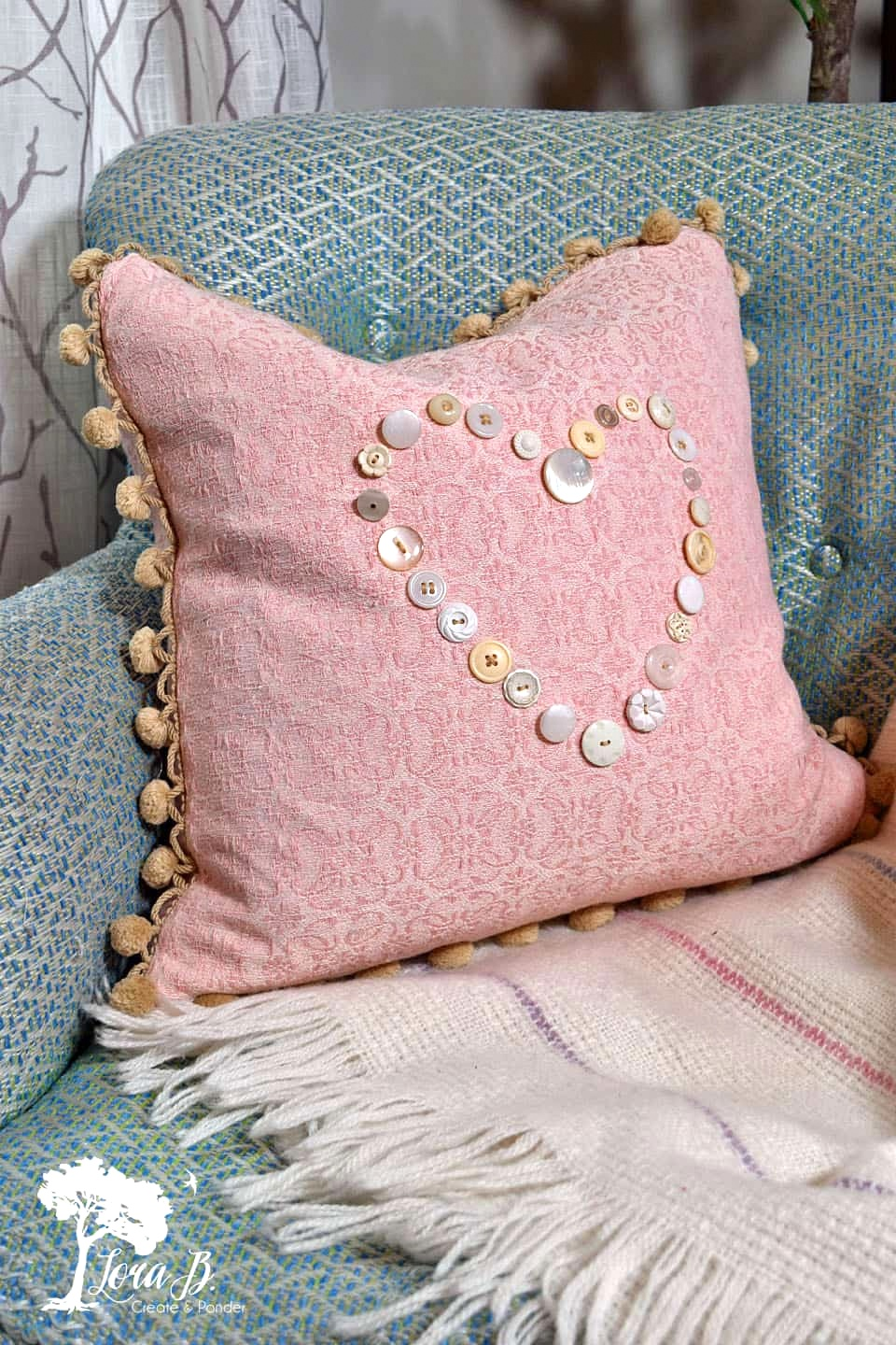 Button heart pillow, part of subtle Valentine's Day decor by Lora B, featured on Funky Junk Interiors