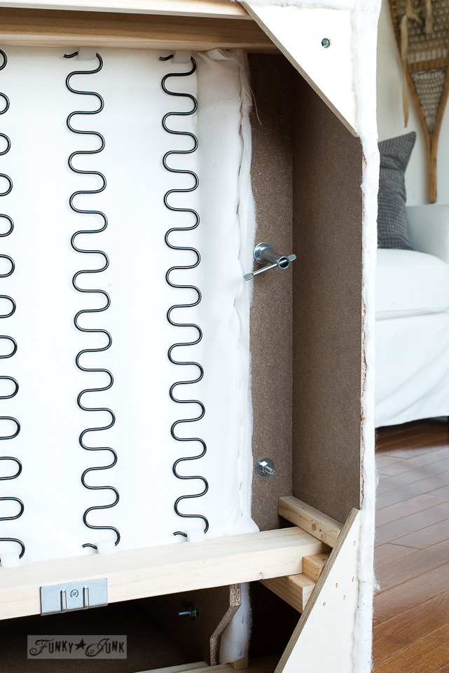 How to assemble the arm of a white slipcovered Ikea Ektorp 3.5 oversized sofa. Click to learn how to put the entire sofa together!