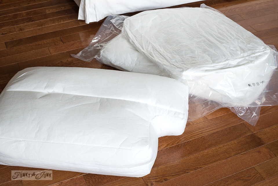 The compressed vacuum packed Ikea Ektorp 3.5 pillows are very compact however do fluff up well! Click to learn how to put the entire sofa together!