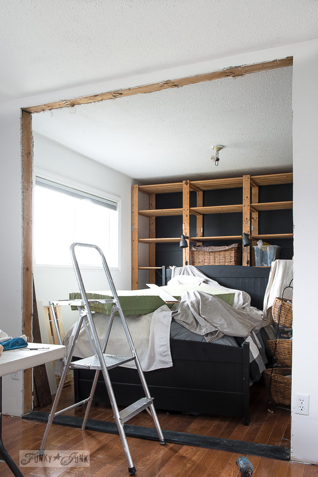 Removing a wall between two small bedrooms to create one large bedroom with a sitting area - during the process.