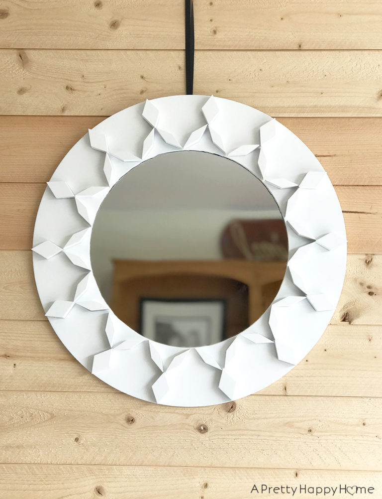 Geometric mirror frame with children's blocks by A Pretty Happy Home, featured on Funky Junk Interiors