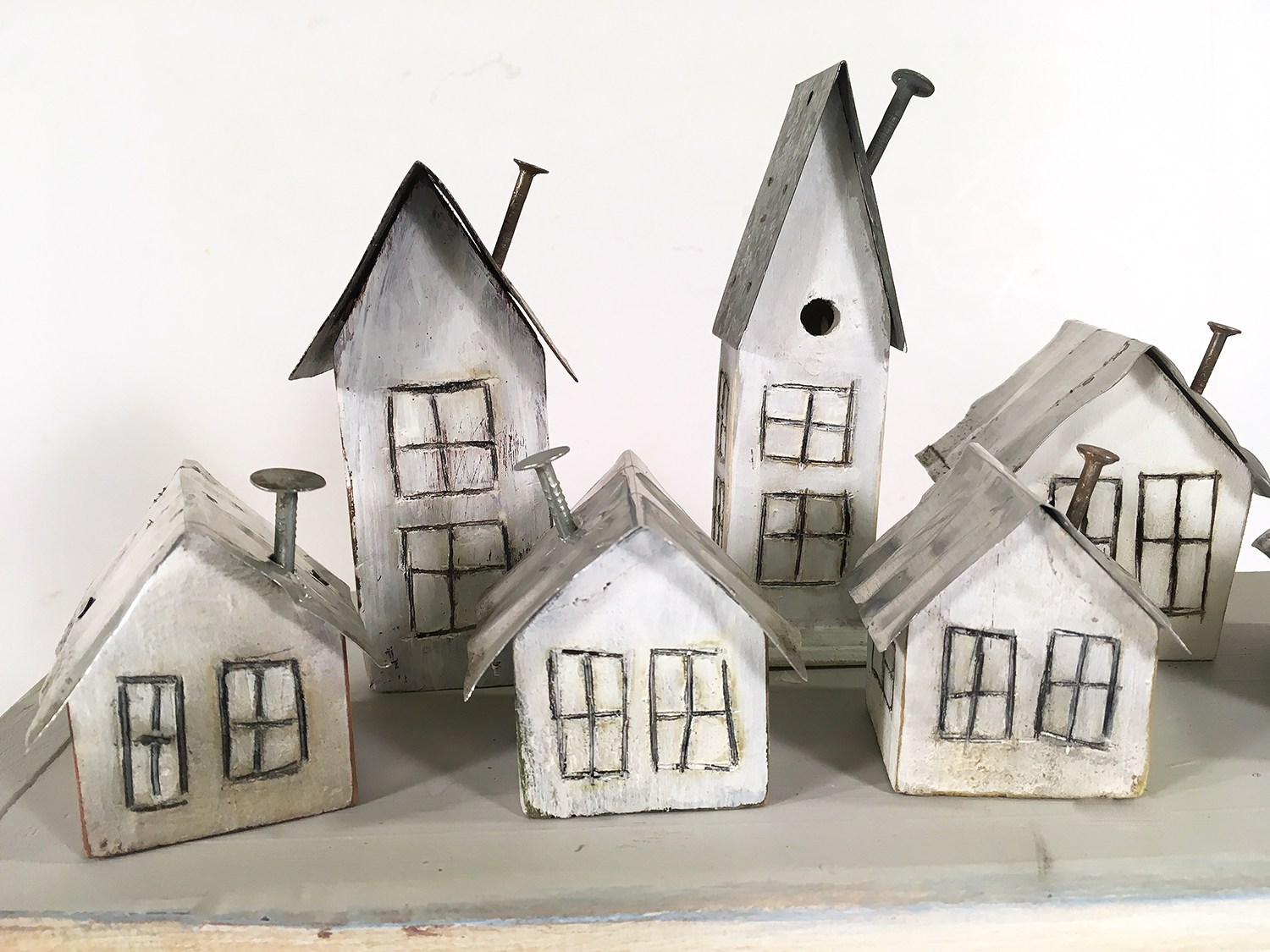 Tiny winter village with nail chimneys by Wisconsin Magpie, featured on Funky Junk Interiors