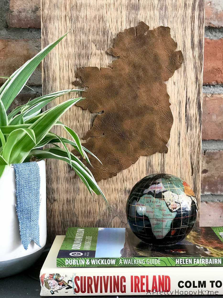 Repurposed leather boots map by A Pretty Happy Home, featured on Funky Junk Interiors