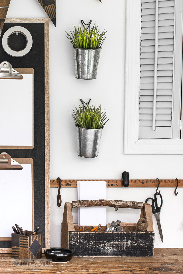 Learn how to make this yardstick with spacers for hanging office gear on a wall, part of a rustic office. #office #bulletinboard #chalkboard