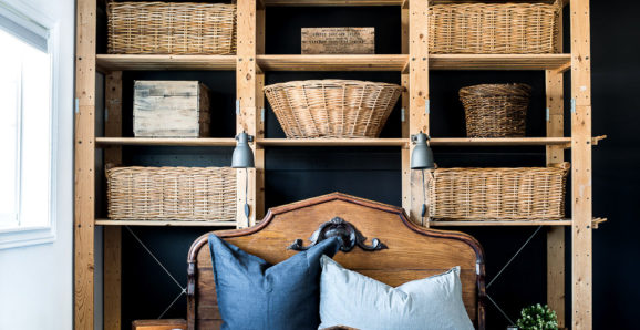 Antique bed with wicker baskets on shelves-001