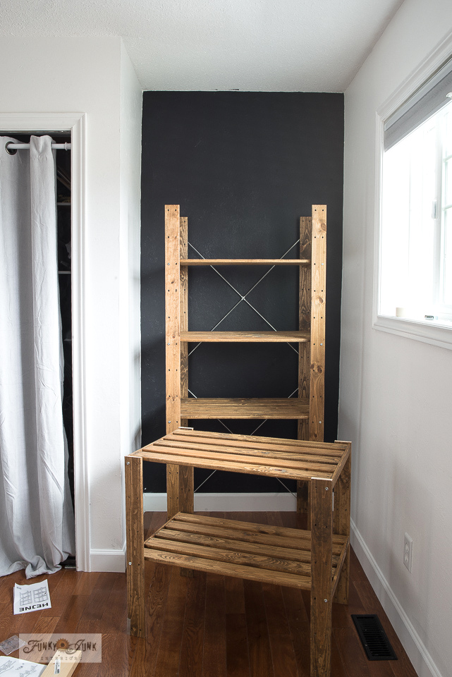 How to turn a new Ikea storage shelf into a rustic farmhouse beauty! The Henjne shelf was stained then extended to the ceiling with a shorter shelf version.