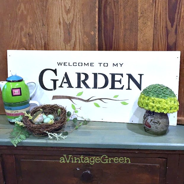 Stenciled plywood garden sign by A Vintage Green, featured on Funky Junk Interiors