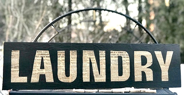 Decoupage newspaper Laundry sign by Homeroad, featured on Funky Junk Interiors