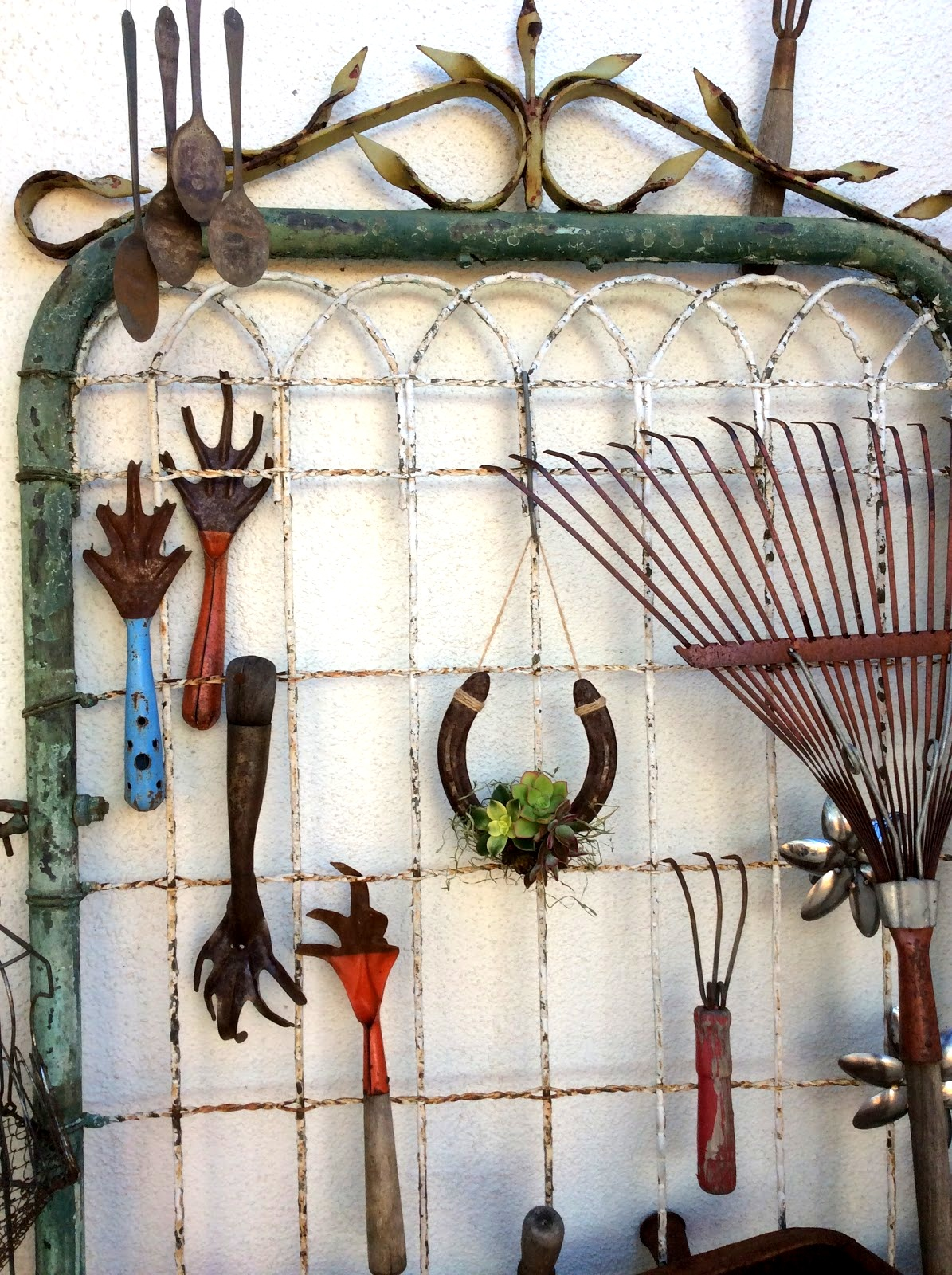 Succulents on a horseshoe and old gate garden tool organizer by Fresh Vintage by Lisa S, featured on Funky Junk Interiors