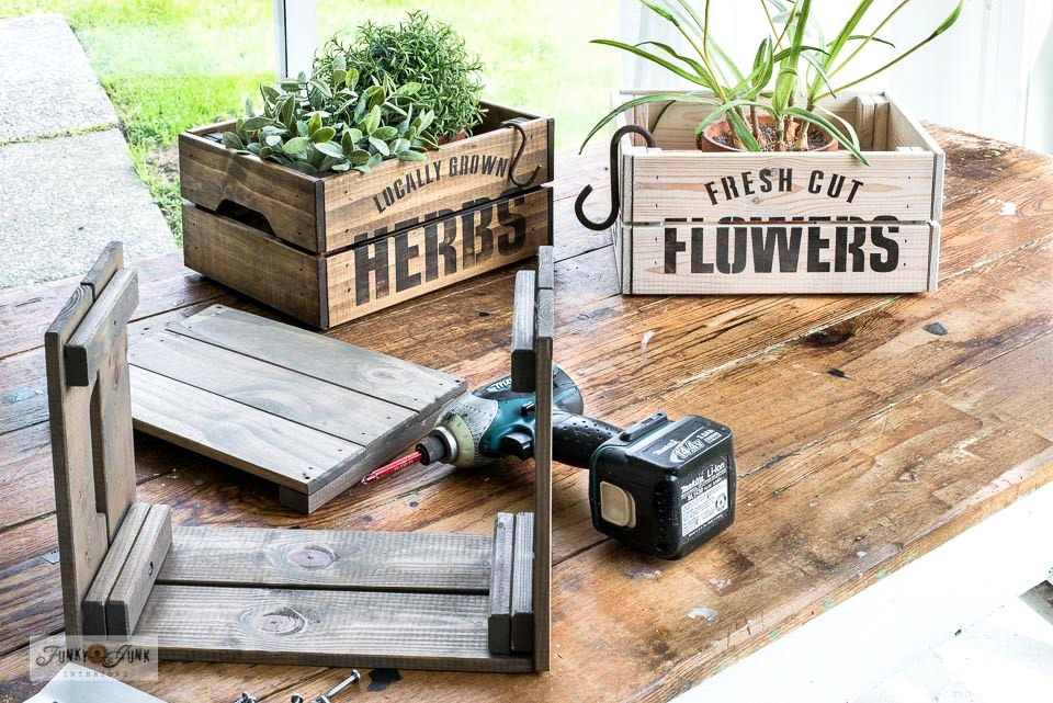 Stencil garden-themed Ikea crates for flowers and plants! Easily assembled, stained, then stenciled with Wild Flower Seeds, Fresh Cut Flowers, and Locally Grown Herbs from Funky Junk's Old Sign Stencils and Fusion Mineral Paint.