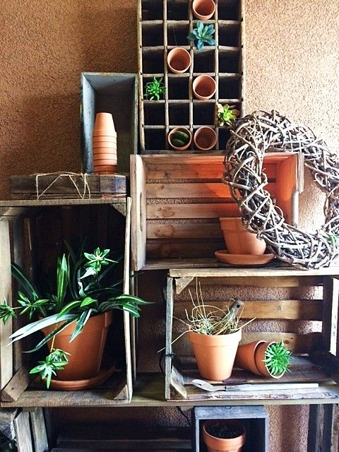 Stacked vintage crates and clay pots by Deb Kennedy, featured on Funky Junk Interiors