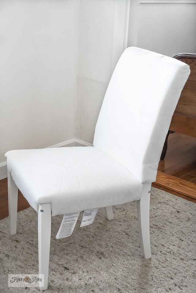 How to assemble and grain sack stripe an Ikea white slipcovered Hendriksdal chair with stencils! Using G1L from Funky Junk's Old Sign Stencils in Fusion Mineral Paint's Ash! Click for the easy tutorial.
