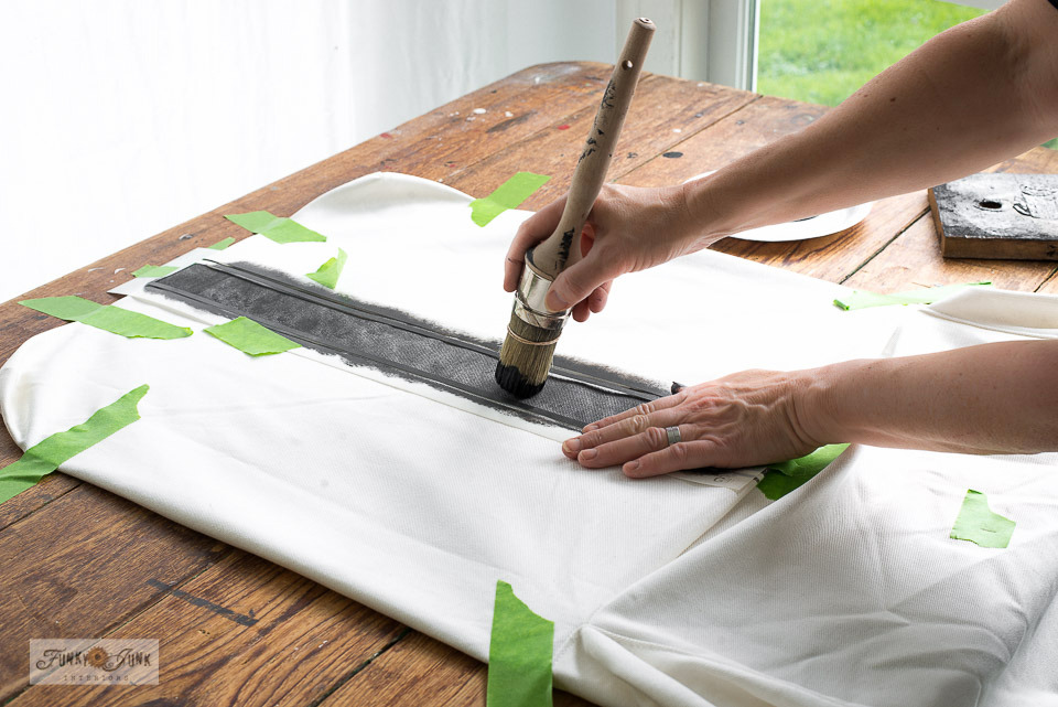How to grain sack stripe an Ikea white slipcovered Hendriksdal chair with stencils! Using G1L from Funky Junk's Old Sign Stencils in Fusion Mineral Paint's Ash! Click for the easy tutorial.