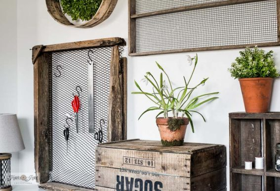 sewing desk with crates and antique soil sifters