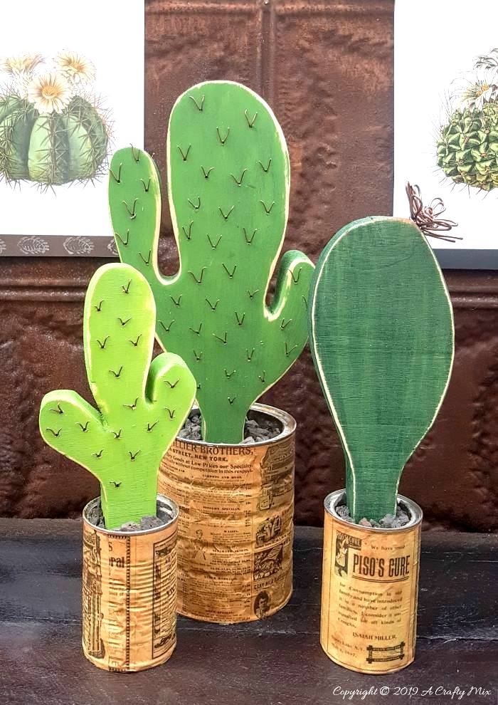 DIY wooden cacti in tin can planters by A Crafty Mix, featured on Funky Junk Interiors