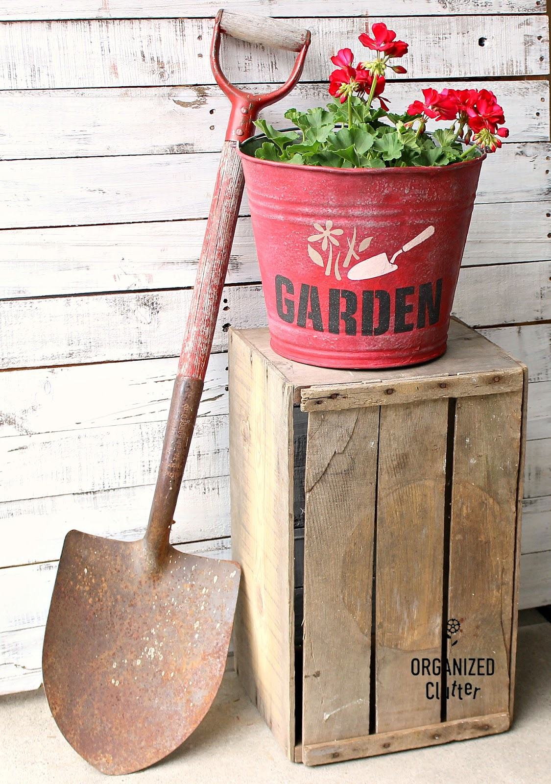 Stenciled red Garden bucket planter by Organized Clutter, featured on Funky Junk Interiors