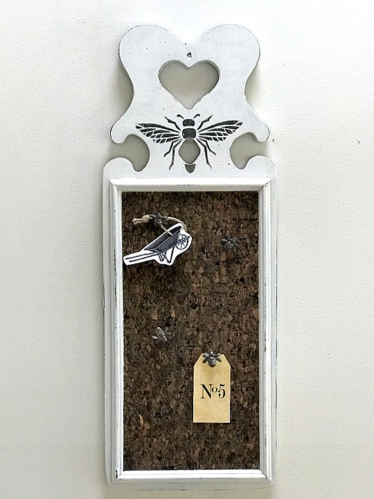 Stenciled bee cork board by Homeroad, featured on Funky Junk Interiors