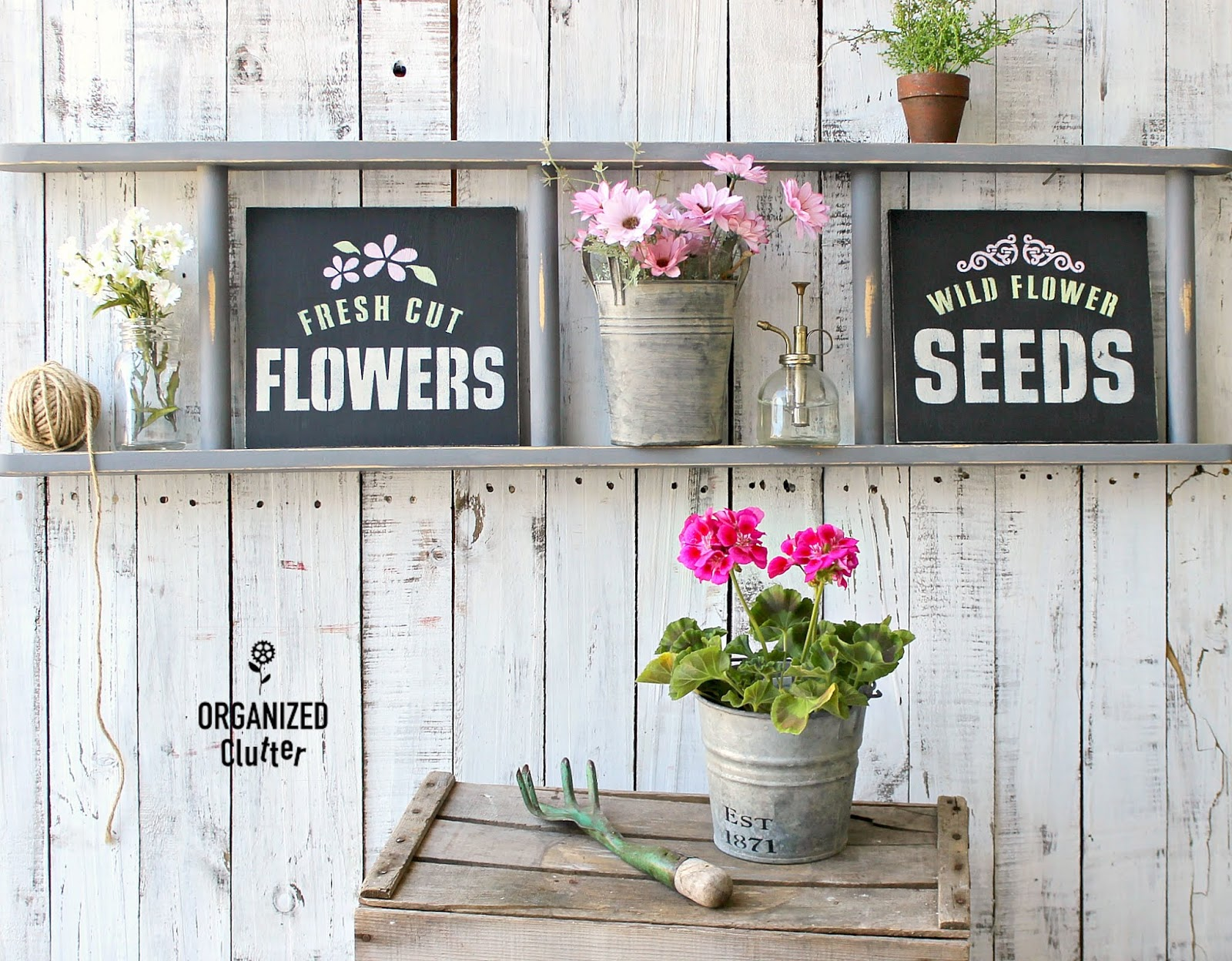 Stenciled garden art on ladder shelf by Organized Clutter, featured on Funky Junk Interiors