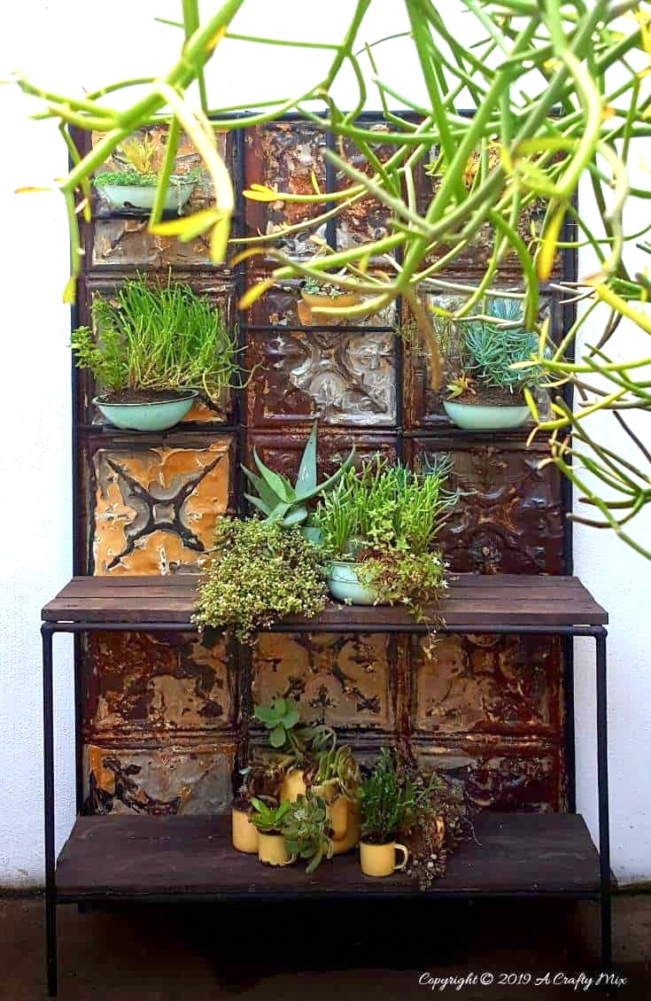 Tin ceiling tile plant stand by A Crafty Mix, featured on Funky Junk Interiors