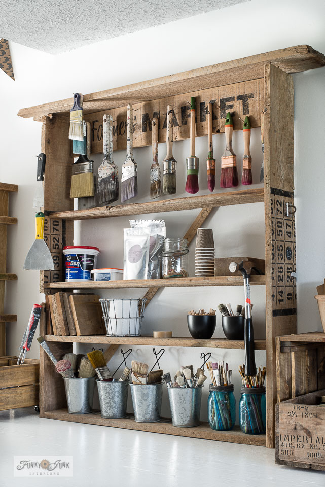 Learn how to make this handy storage paint shelf made out of fence planks!