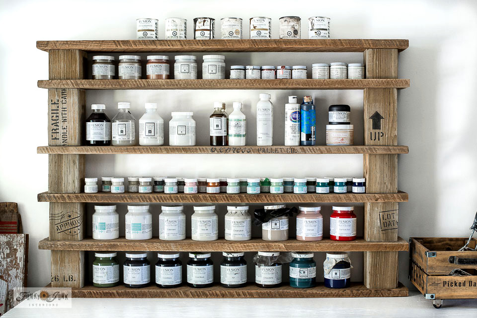Learn how to make this no-build wood block crate styled paint shelving with stock lumber and Shipping Crate Stamps from Funky Junk's Old Sign Stencils!