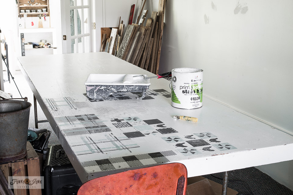 painting the wooden work table in the paint studio