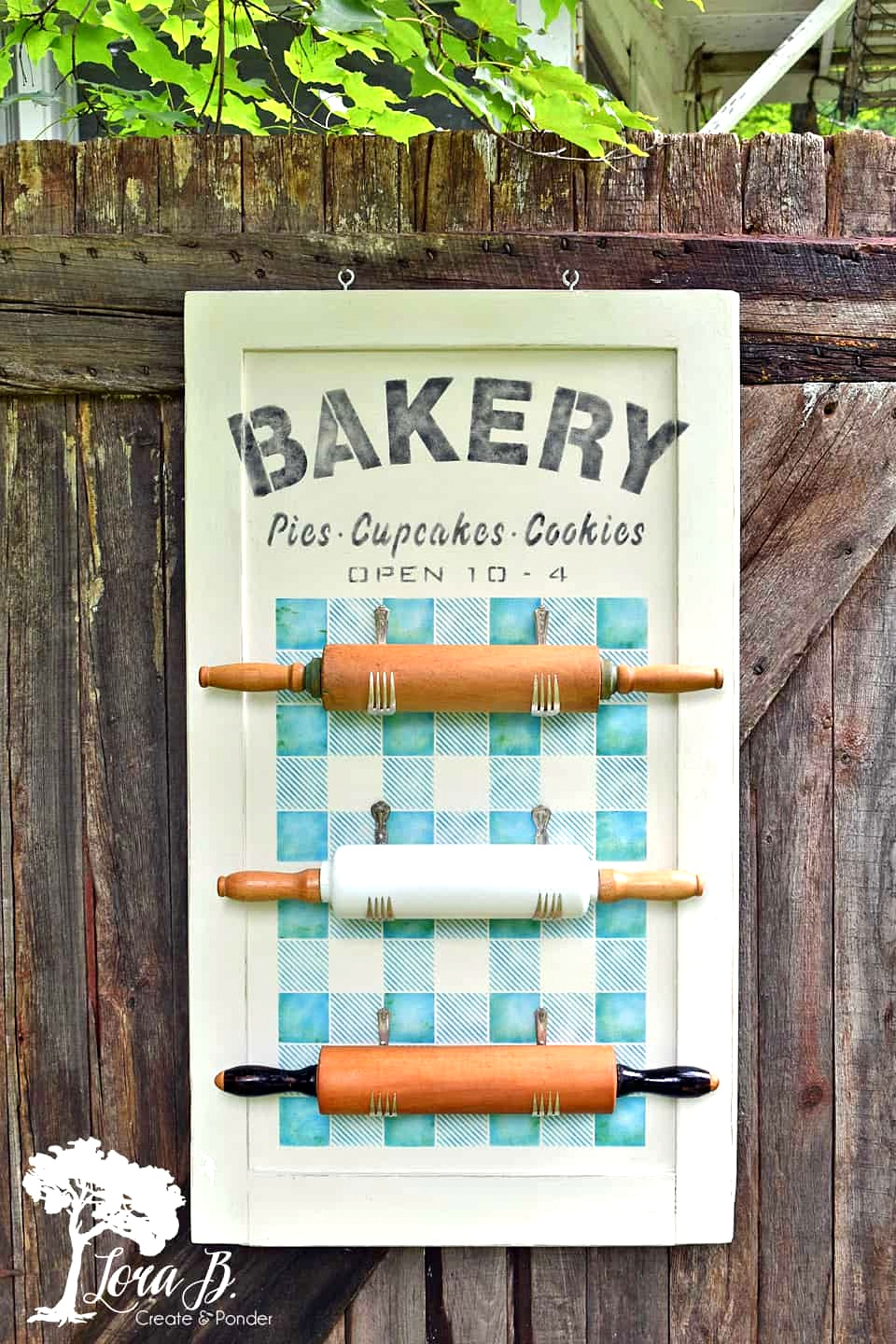 Bakery sign with vintage rolling pin display by Lora B, featured on Funky Junk Interiors