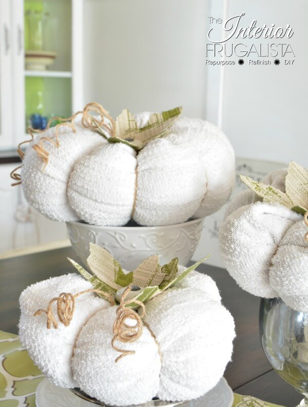Sweater pumpkins with cabinet knob stems by Interior Frugalista, featured on Funky Junk Interiors