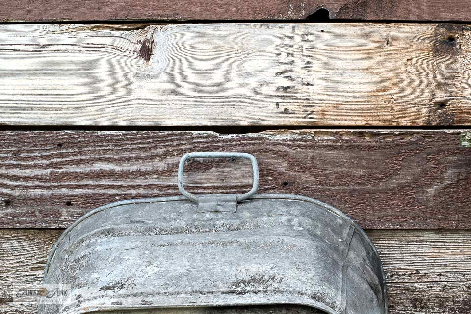 Learn how to make this unique reclaimed wood tool fence with Farm Supply sign and Shipping Crate Stamps, perfect as a rustic backdrop for any garden or yard! Made with Funky Junk's Old Sign Stencils. Click for tutorial.