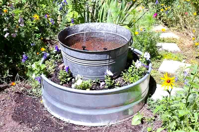 Galvanized solar water fountain garden planter by Flower Patch Farmhouse, featured on Funky Junk Interiors